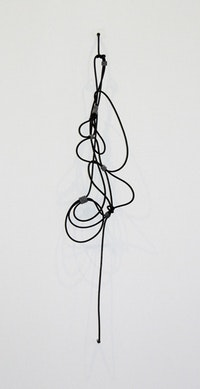 "Jennie C. Jones, ""Shhh #1"" (2010). Professional noise canceling instrument cable, wire and felt. Approx. 47 x 10 x 6.25 inches (119.4 x 25.4 x 15.9 cm). Courtesy of the artist and Sikkema Jenkins & Co., New York."