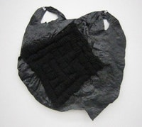 "Josh Blackwell ""Untitled (corked),"" (2010) plastic bag, organic yarn, 16 1/2 x 15 1/2 inches."