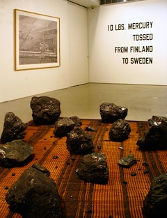 Installation view of: Terry Adkins & Blanche Bruce, Cinnabar (2010), Sophie Ristelhueber, Because of Dust Breeding (2007) and Lawrence Weiner, 10 LBS. MECURY TOSSED FROM FINLAND TO SWEDEN (1970). All images courtesy of the gallery.