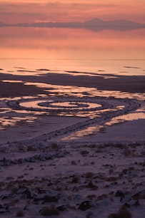 """""""Spiral Jetty"""" at sunset, January 4, 2011, 1970, Great Salt Lake, Utah. Collection Dia Art Foundation. Photo ©Greg Lindquist. ©Estate of Robert Smithson/Licensed by VAGA, New York."""