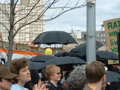 Individuals symbolically protesting the shadows  cast by Ratner's proposed highrises by holding open umbrellas.