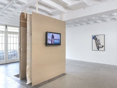 "Deborah Ligorio. Sculptural structure inside outside (2011). Wood, cotton, lime paint,video 6 hours looped, hard drive, media player, TV. Video: ""Lungomare"" (2011). ""Scena di Strada"" (2011), collage on paper. Courtesy sommer&kohl, berlin."