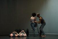 Liz Lerman Dance Exchange in The Matter of Origins.. Photo by George Hagegeorge. Sarah on chair.