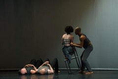 Liz Lerman Dance Exchange in The Matter of Origins.. Photo by George Hagegeorge. Sarah on chair.