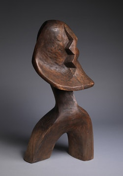 """Rainbow Figure,"" 1965. Wood. 38 x 18 x 15"".  Courtesy of the artist and DC Moore Gallery, NY."