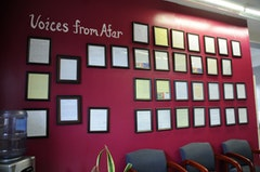 Letters from the incarcerated parents of students sit framed on the wall.