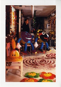 Tamara Gonzales, 2001 in her studio with work for exhibition: Panna 3. Exhibition at Cheryl Pelavin Fine Arts, LLC. March 8 to April 28, 2001. Mixed media, plastic balloon dolls, hand painted by the artist. Photograph by Cheryl Pelavin.