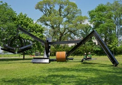 """She,"" 1977–1978. Steel and wood swinging bed. 17' × 52' × 28'. Photograph by Jerry L. Thompson"