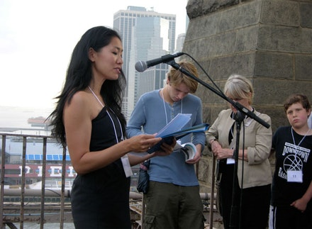 Brooklyn Poet Laureate Tina Chang reads on the Brooklyn Bridge on the Poets House Poetry Walk, 2010. Photo by David St.-Lascaux.