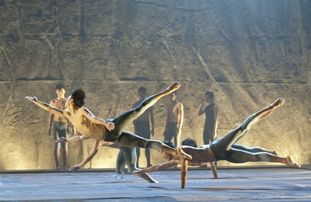Dancers in <i>Haze</i> dive out over the soft, padded stage.