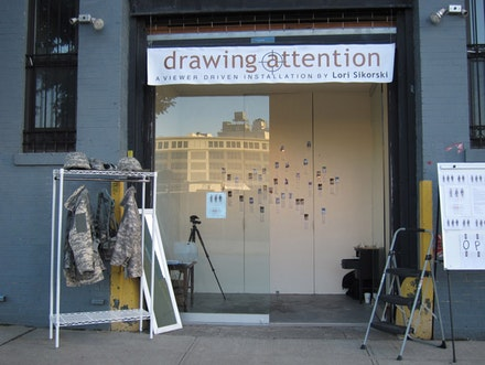 "Participant viewing ""Drawing Attention."""