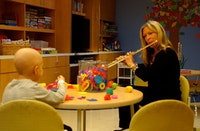 Flutist, doing a Music That Heals program for a children's out-patient unit. Photo courtesy of Kathy Nicolosi.