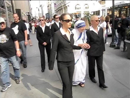 <i>Linda Mary Montano Celebrates Mother Teresa's Birthday at Empire State Building</i>, 2010. Photo credit: Mark Shaw. Video collaborators: Miss Toni Silver, Leah Aron, Dominique Rodriguez, Zhenesse Heineman.