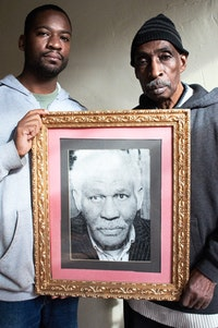 <i>Local activist named Ted (left) and Clarence Hardy (right), holding a photo of Judge John Phillips, founder of the Slave Theater (November 2011).</i>