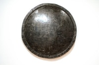 "Alejandra Prieto, ""Concave Coal Mirror."" Coal. 72"" diameter. Courtesy Y Gallery."