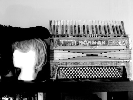 Accordion and alter ego, waiting to play. Photo by Michelle Memran.
