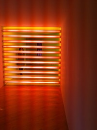 "Dan Flavin, ""untitled (to Robert, Joe and Michael),"" 1975–81. Pink and yellow fluorescent light. Installed in a corridor 8 x 8'. Edition 2/3. Photo: Greg Lindquist. Courtesy the Estate of Dan Flavin."