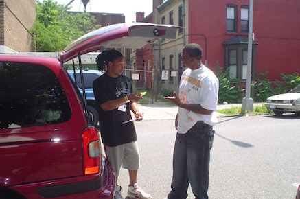 Outreach worker from Project Street Beat handing out condoms and HIV prevention information. Reprinted with permission from Planned Parenthood of New York City.