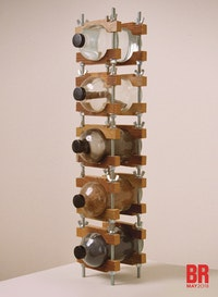 Mel Chin, <em>Vertical Palette</em>, 1976-86. Lead, wood, water, smoke, clay, in scientific glass storage bottles with Bakelite caps in artist-designed rack of oak and steel, 28 1/4 x 6 1/4 x 8 1/2 inches. Courtesy the artist.