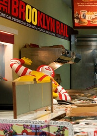 "COVER: Superflex. Still photo from ""Flooded McDonald's"" (2008). Courtesy of Superflex and Peter Blum Gallery"